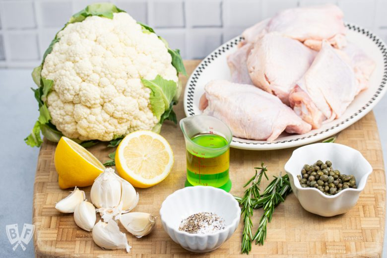 Ingredients for a keto roasted lemon-rosemary chicken & cauliflower recipe