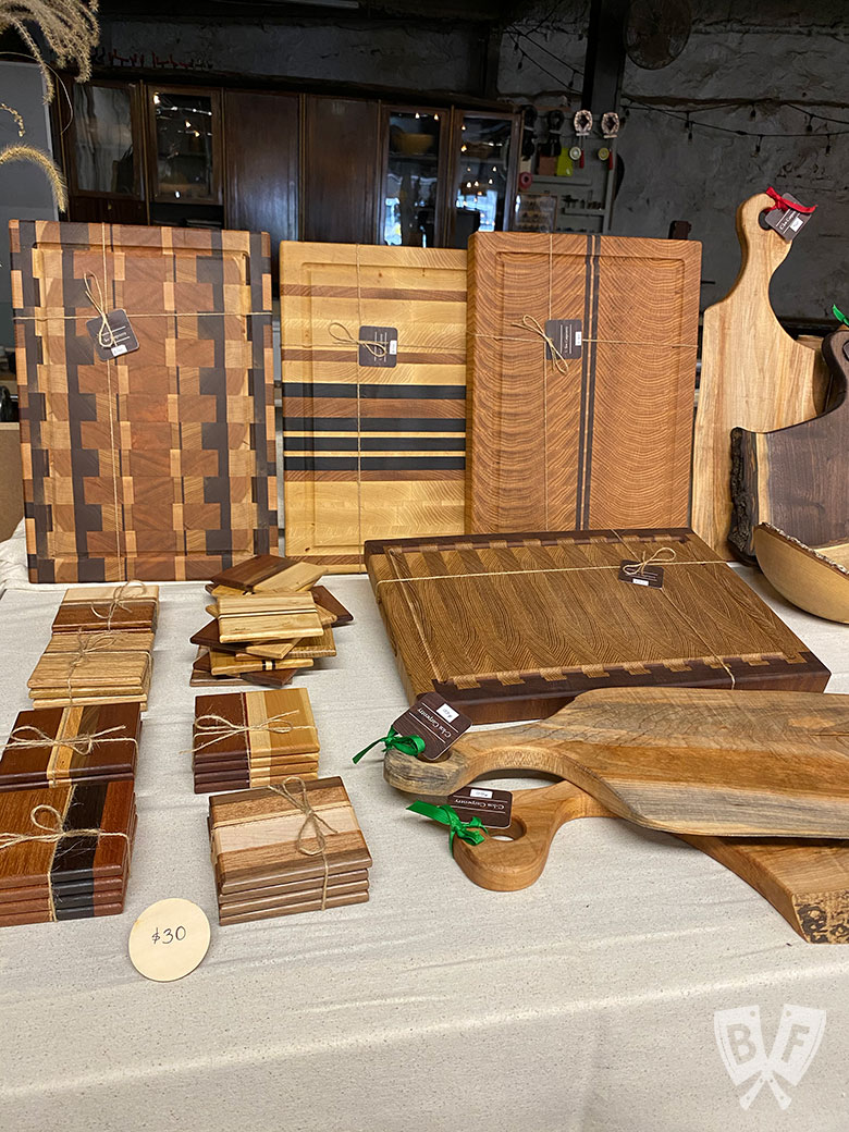 Display of handmade wood cheeseboards and coasters from C.los Carpentry.