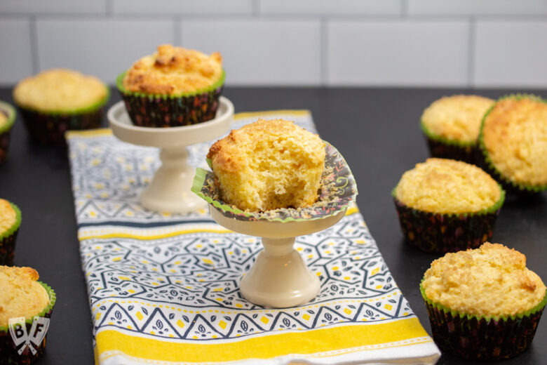 Sweet corn muffin with a bite taken out of it surrounded by more muffins.