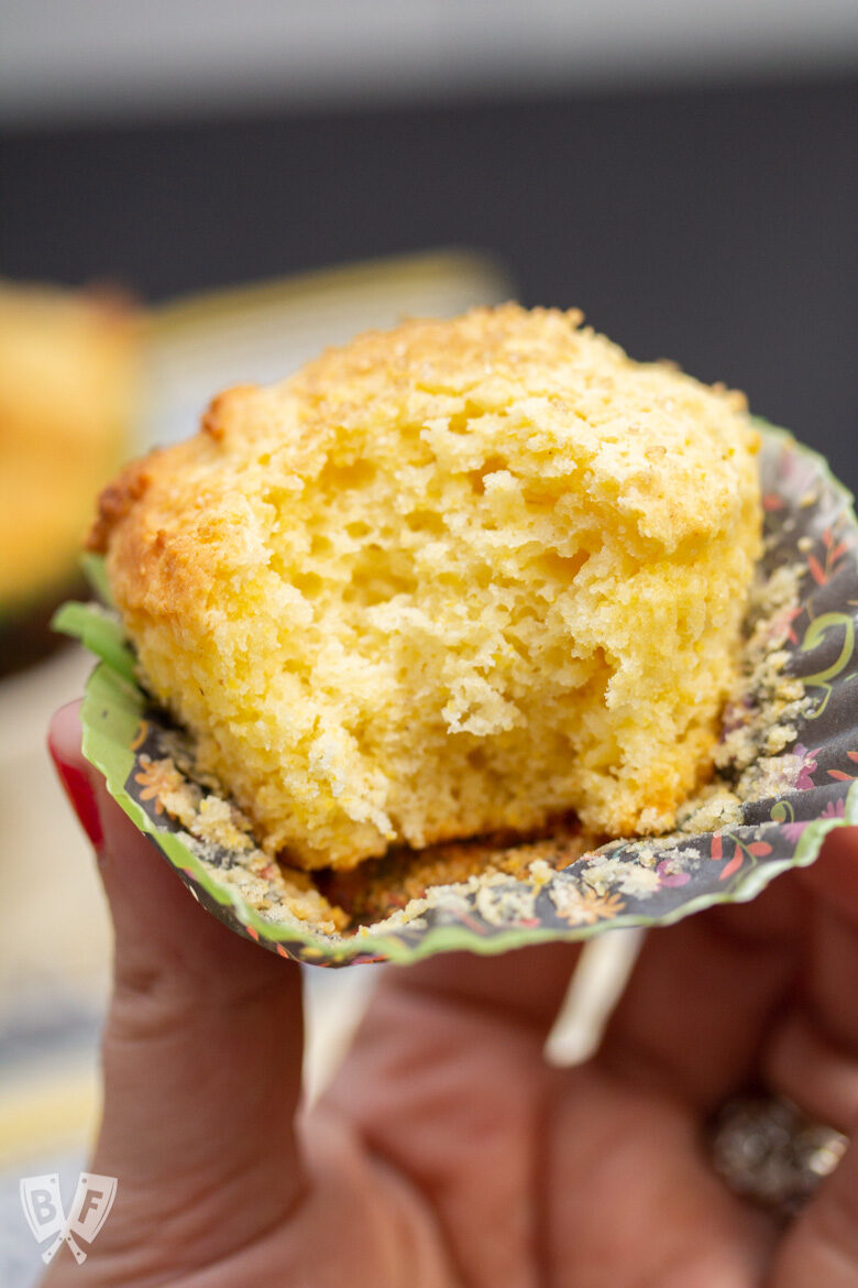 Close-up of a sweet corn muffin with a bite taken out.