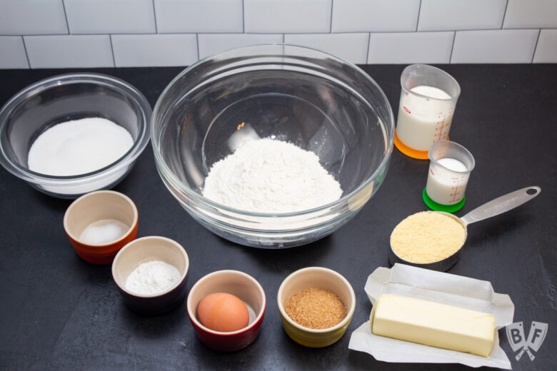 Baking ingredients laid out to make sweet corn muffins.
