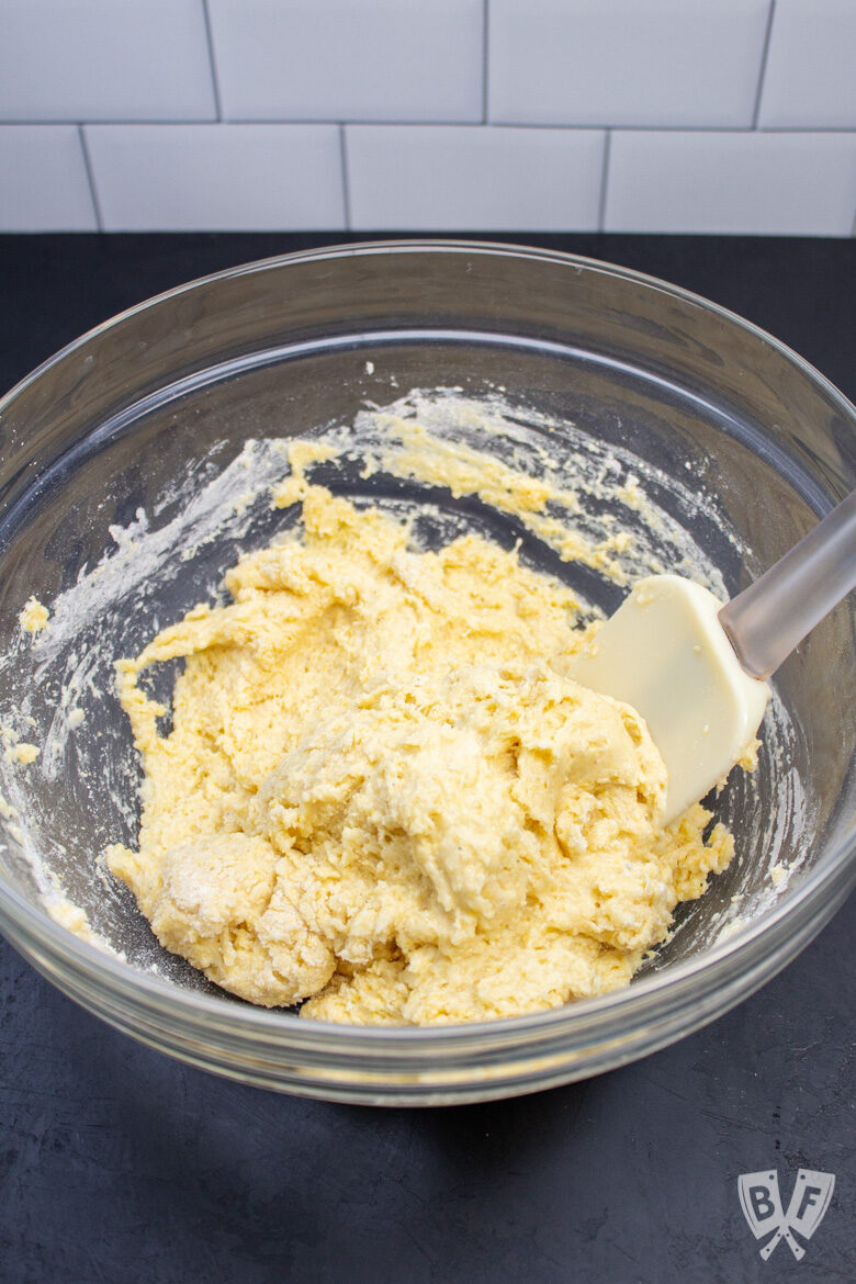 Bowl of sweet corn muffin batter with a spatula.