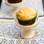 Sweet corn muffins on top of muffin stands.