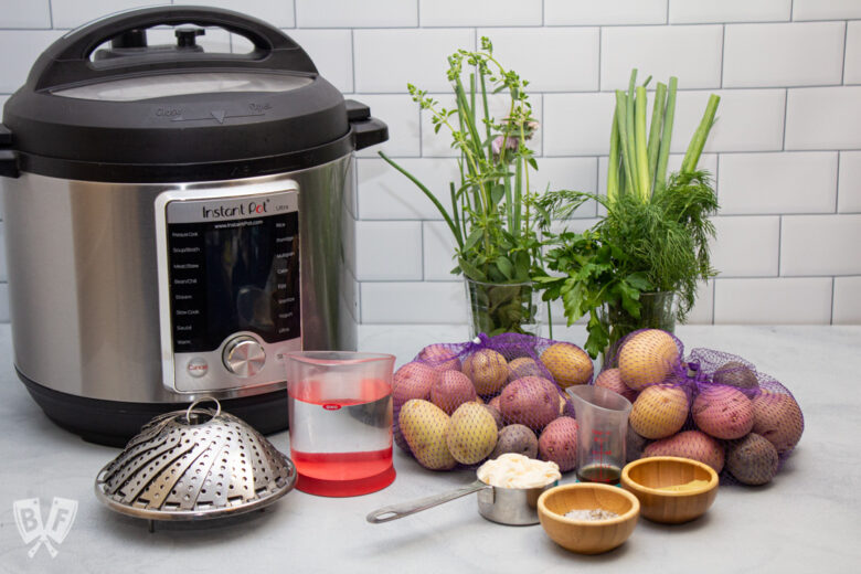 Instant Pot and ingredients for making potato salad with fresh herbs.
