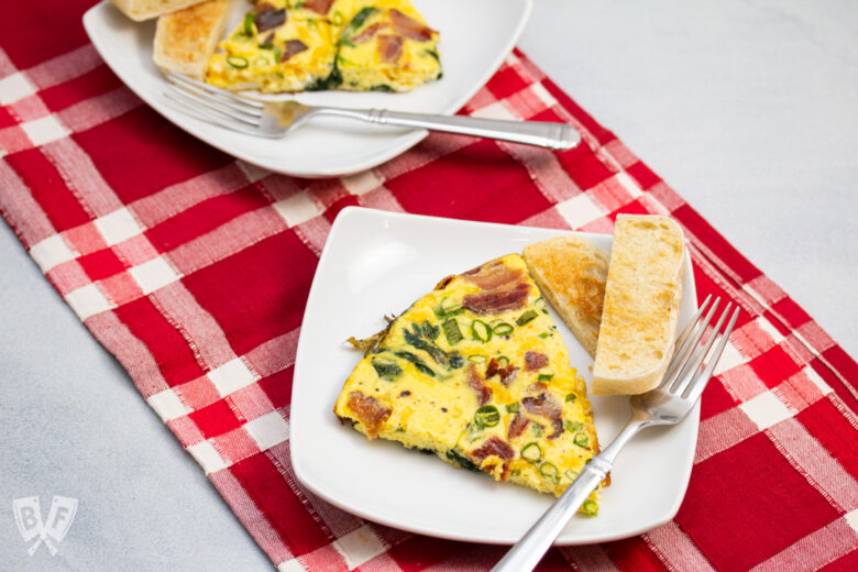 Spinach, bacon, green onion, and cheddar frittata with toasted English muffin.
